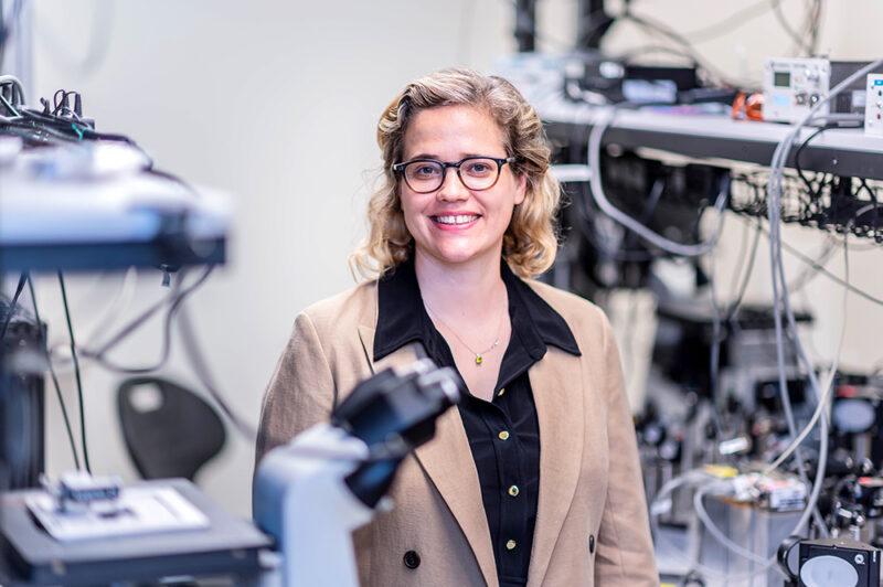 blonde femal scientist standing in lab